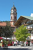 Obermarkt with a view of the Church of St. Peter and Paul, Mittenwald, Upper Bavaria, Bavaria, Germany
