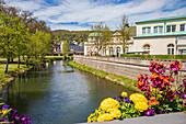 Promenade and arcade footbridge on the Franconian Saale in Bad Kissingen, Bavaria, Germany