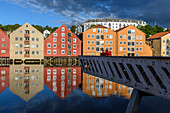 People on viewing platform on the Nidelv River with old warehouses, Trondheim, Norway