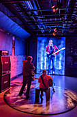 Visitors try out musical instruments at the Norwegian National Museum of Pop and Rock Music Rockheim, Trondheim, Norway