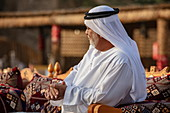 Arab man at a local festival, near Al Ain, Abu Dhabi, United Arab Emirates, Middle East