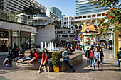 People relax in the courtyard of the 1881 Heritage Shopping Complex in Kowloon, Hong Kong, Hong Kong, China, Asia