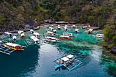 Aerial view of traditional Filipino Banca outrigger canoes lying in the lagoon near Lake Kayangan, Banuang Daan, Coron, Palawan, Philippines, Asia