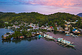 Aerial view of houses on stilts and traditional Filipino Banca outrigger canoes, Barangay II, Coron, Palawan, Philippines, Asia