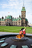 Tourists take selfie photo by the Eternal Flame in front of the Parliament Building, Ottawa, Ontario, Canada, North America