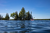 Low view of the water surface on a canoe on Indian Lake, near Chaffey's Lock, Ontario, Canada, North America