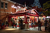 People queue for famous BeaverTail cinnamon rolls at BeaverTails Bakery at night, Ottawa, Ontario, Canada, North America