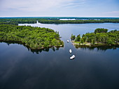 Aerial view of three Le Boat Horizon houseboats on Indian Lake, near Chaffey's Lock, Ontario, Canada, North America