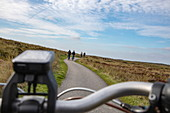 View through the handlebars of an electric bicycle on a cycle path, near Hoorn, Terschelling, West Frisian Islands, Friesland, Netherlands, Europe
