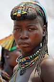 Angola; western part of the province of Cunene; young woman from the Mucohona ethnic group; with typical head and neck jewelry