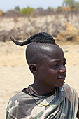 Angola; southern part of Namibe Province; Muhimba boy with traditional hairstyling