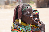 Angola; Huila Province; small village near Chibia; Muhila women with typical neck and headdress; Tufts of hair covered with clay and fixed; massive choker made of pearl necklaces and earth