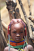 Angola; Huila Province; small village near Chibia; Muhila girl with typical neck and headdress; Tufts of hair covered with clay and fixed; Choker made of pearls and earth
