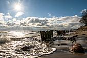 Groynes in the sunlight on the beach at Kellenhusen Baltic Sea, Ostholstein, Schleswig-Holstein, Germany