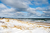 Clouds, wind and snow on the beach in Dahme, Baltic Sea, Ostholstein, Schleswig-Holstein, Germany