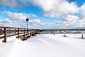 View of the snow-drifted pier in Dahme, Baltic Sea, Ostholstein, Schleswig-Holstein, Germany