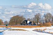 View of the snow-covered Paasch-Eyler-Platz in Grube, Ostholstein, Schleswig-Holstein, Germany