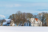 View of the old school in Siggeneben in the snow, Grube, Ostholstein, Schleswig-Holstein, Germany