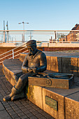 The seated fisherman (sculpture) in Kappeln in the morning, Kappeln, Schlei, fishing, Schleswig-Holstein, Germany