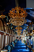 Aisle with chandeliers on the Hurtigruten ship Richard With between Bronnoysund and Rorvik, Norway