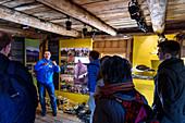 Guided tour of the world heritage exhibition (eider ducks), wooden house village Nes, Vega island, Norway