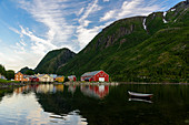 Old wooden houses by the harbor at high tide in Mosjöen, Norway
