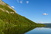 Lake with hut south of Svartisen Glacier, Norway