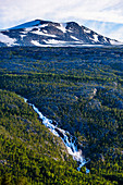 Barrelfall and snow-capped mountain on the E6 Saltfjell, Norway
