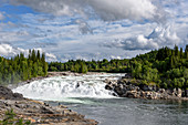 The river Vefsna with the waterfall Laksfossen, Norway