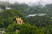 View of Hohenschwangau Castle and surroundings with low clouds, Schwangau, Upper Bavaria, Germany