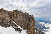 View from Zugspitze summit to summit cross and mountain landscape, Grainau, Upper Bavaria, Germany