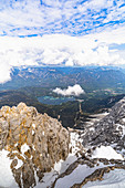View from Zugspitze summit to the turquoise blue Eibsee, Grainau, Upper Bavaria, Germany