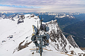 View from Zugspitze summit to surrounding snow-covered mountain landscape, Grainau, Upper Bavaria, Germany