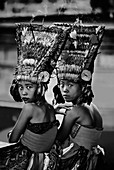 Adolescent Balinese girls on Hindu temple grounds during the festival of Galungan and Kuningan, Karangasem, Bali, Indonesia