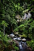 A river flows peacefully through Hindu temple Gunung Kawi in Gianyar, Bali, Indonesia.