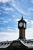 The clock tower on the Brighton Palace Pier against a spring sky, Brighton, East Sussex, UK.