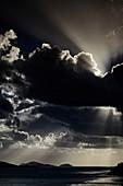Rainclouds roll over a sunrise on Hamilton Island, Whitsunday Islands, Queensland, Australia.