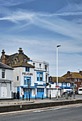 Streetscape of the Hastings seafront on East Parade with seafood restaurants, East Sussex, UK.