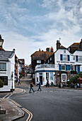 A streetscape of shops, residences and the Mermaid Street Cafe on Mermaid Street, Rye, East Sussex, UK.