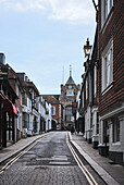 A streetscape of a laneway with residences and shops in Rye, East Sussex, UK.