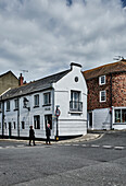 A streetscape with tourists in Wish Ward in Rye, East Sussex, UK.
