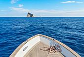 Boat sailing at Basiluzzo cliff, Panarea, Aeolian Islands, Sicily, Italy