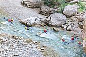 Group of people canyoning in Verdon river, Gorges du Verdon, Alpes de Haute Provence, Provence, France