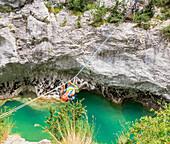 Man crossing the Verdon river on a rope, Gorges du Verdon, Alpes de Haute Provence, Provence, France