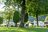 Camping ground at Millstaetter See in the morning light, Döbriach, Austria, Europe.