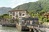 Shipping pier of Lenno on Lake Como seen from the lake side, Lombardy, Italy