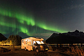 Motorhome and polar lights, aurora borealis, northern lights, Lofoten, Norway, Scandinavia
