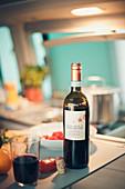 Motorhome interior, wine bottle and kitchen utensils in VW bus kitchen, Bulli,
