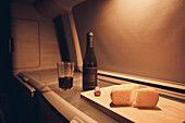 Motorhome interior, VW T6 California, cheese and wine in VW bus kitchen, Bulli