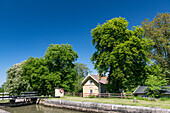 Lock on the Göta Canal with bridge and house in Hajstorp, Västra Götaland, Sweden